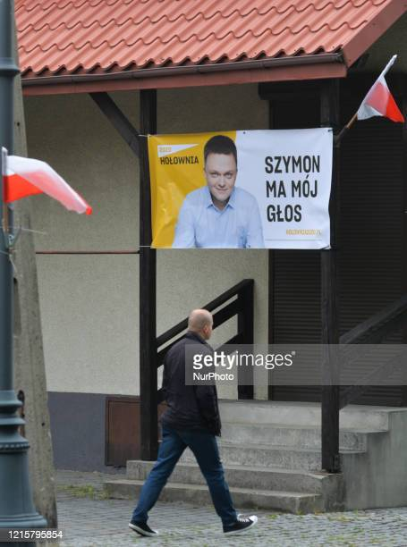A man walks by an election poster of Szymon Holownia an independent candidate for the Presidential Election 2020 seen in Alwernia On Wednesday May 27...