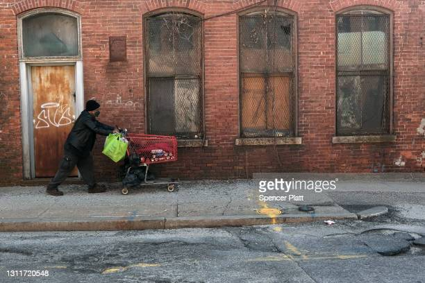 Man walks by an old factory on April 09, 2021 in Pawtucket, Rhode Island. Rhode Island consistently ranks as one of the worst states in America for...