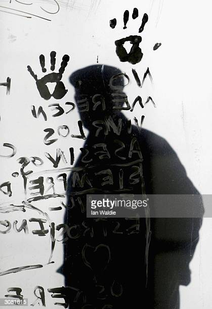 A man walks by antiterrorism slogans painted on a window at Atocha train station March 13 2004 in Madrid Spain Ten bombs exploded March 11 killing...