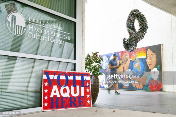 Man walks by as the voting polls open at the Mexican American Cultural Center on November 6, 2018 in Austin, Texas. - Americans started voting...