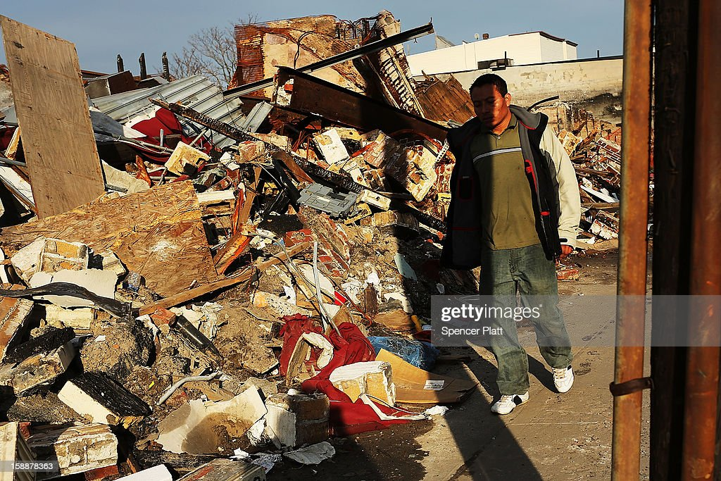 A man walks by homes and businesses destroyed by Superstorm Sandy in the Rockaways on January 2, 2013 in the Queens borough of New York City. Criticism, including by President Barack Obama, has been directed at the Republican House's decision to adjourn without passing a Superstorm Sandy aid bill. According to early estimates, Superstorm Sandy inflicted at least $50 to $60 billion in damage across the Northeast, making it one of the most destructive storms ever.