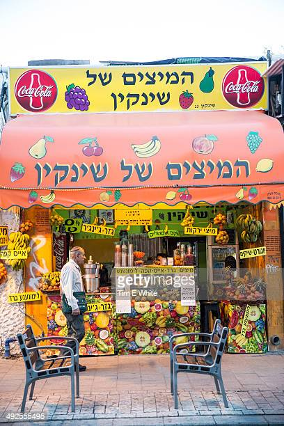 Man walks by Juice vendor, Tel Aviv, Israel