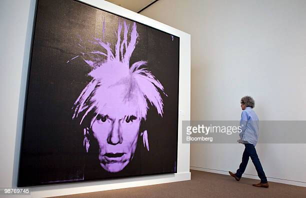 A man walks by Self Portrait by Andy Warhol during a press preview at Sotheby's in New York US on Friday April 30 2010 The piece is estimated to sell...
