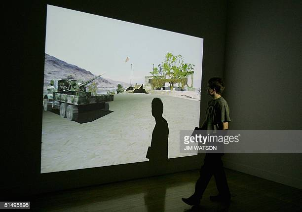 A man walks by shortlisted artists Langlands Bell's interactive digital reconstruction of 'The House of Osma bin Laden' which allows visitors to...