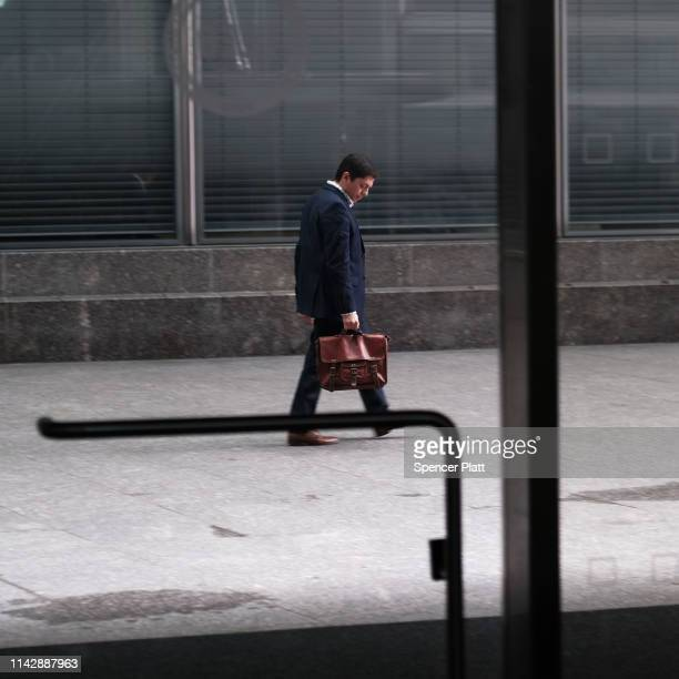A man walks by the Goldman Sachs New York headquarters on April 15 2019 in New York City Goldman Sachs the global investment banking firm reported...