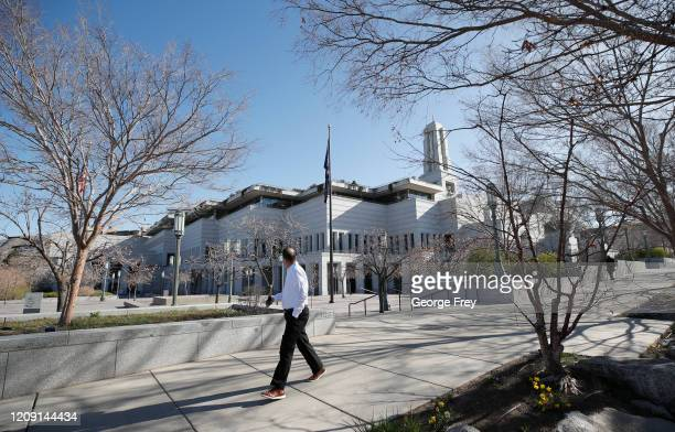 A man walks by the grounds of the Conference Center that sit empty for the 190th Annual General Conference of the Church of Jesus Christ of LatterDay...