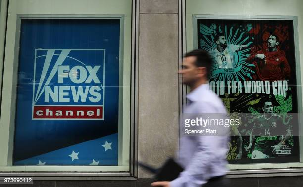 A man walks by the headquarters of 21st Century Fox on June 13 2018 in New York City Comcast the giant cable operator on Wednesday officially made a...