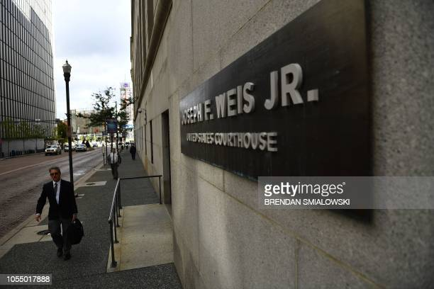 A man walks by the Joseph F Weis Jr US Courthouse where Robert Bowers the man accused of killing 11 worshippers in a Pittsburgh synagogue on October...