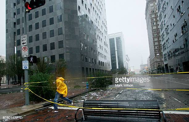 A man walks by the JP Morgan Chase Tower which had many windows blown out when Hurricane Ike passed through the city September 13 2008 in Houston...