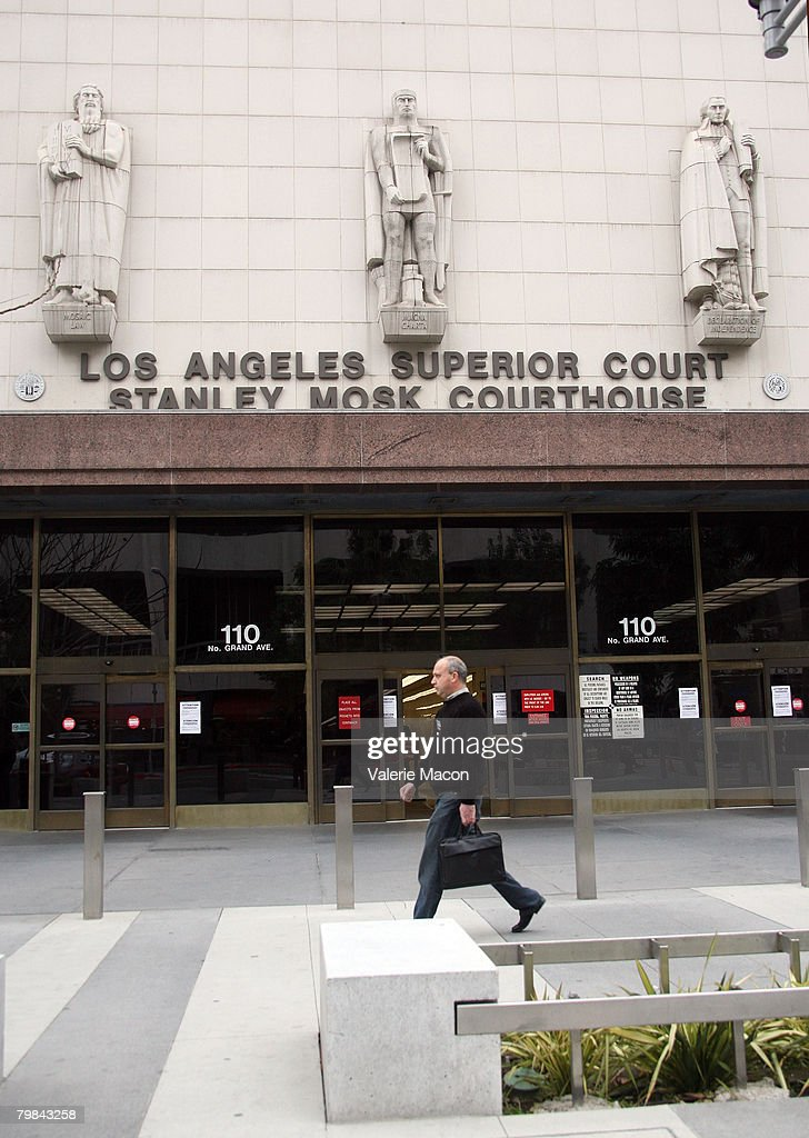 A man walks by the Los Angeles County Superior courthouse