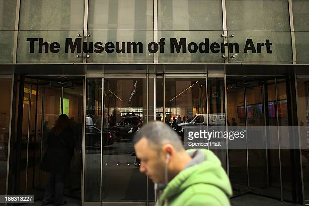 A man walks by the Museum of Modern Art on April 11 2013 in New York City MoMA announced yesterday that it will demolish the former Museum of...