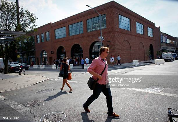 A man walks by the new Brooklyn Apple Store during a media preview in the Williamsburg neighborhood of Brooklyn on July 28 2016 in New York City The...