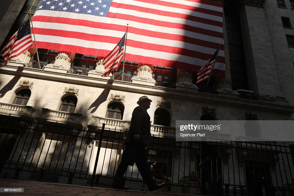 A man walks by the New York Stock Exchange (NYSE) on July 12, 2018 in New York City. As fears of a trade war eased with China, the Dow Jones Industrial Average rose 140 points in morning trading.