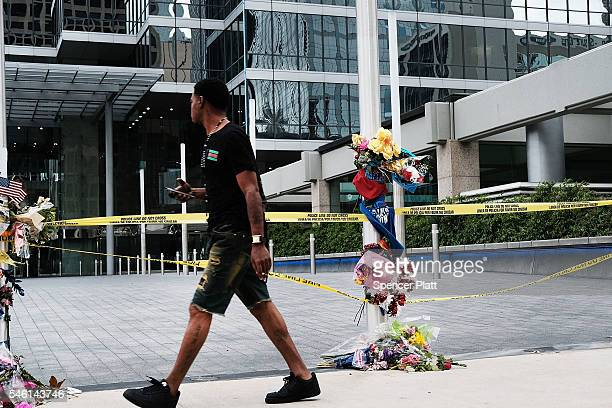 A man walks by the scene of Thursday evenings shooting in downtown Dallas on July 11 2016 in Dallas Texas Most of Dallas got back to work on Monday...