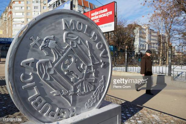 Man walks by the sign of a school as voters cast their ballot during the parliamentary elections on February 24, 2019 in Chisinau, Moldova.