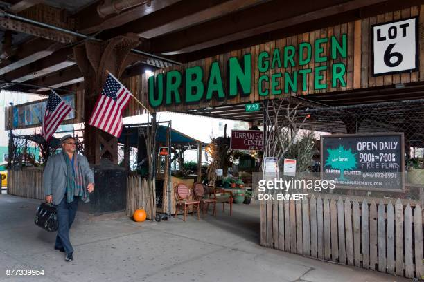 A man walks by the Urban Garden on 116th St and Park Ave in Harlem on November 14 2017 in New York Harlem was the neighborhood where Ella Fitzgerald...
