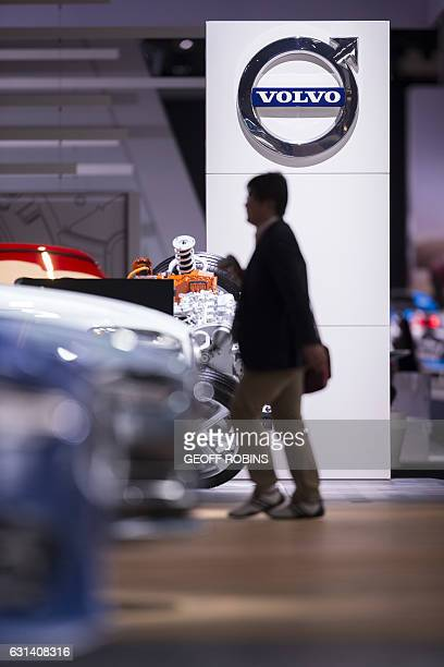 A man walks by the Volvo sign at the 2017 North American International Auto Show in Detroit Michigan January 10 2017 / AFP / Geoff Robins