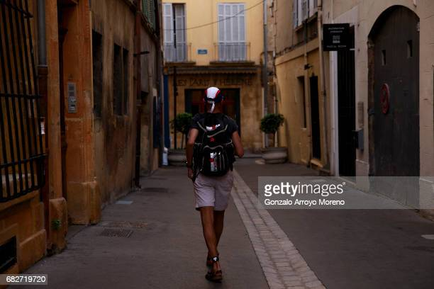A man walks carrying an Ironman backpack across a street the day before of the Ironman 703 Pays d'Aix on May 13 2017 in AixenProvence France