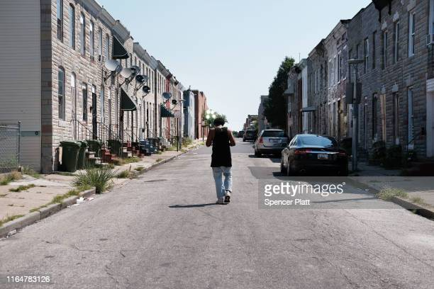 Man walks down a Baltimore street near where a person was recently murdered on July 28, 2019 in Baltimore, Maryland. President Donald Trump has...