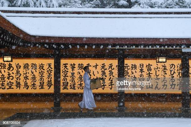 A man walks down a hallway at the Meiji Jingu Shrine on January 22 2018 in Tokyo Japan The Japan Meteorological Agency has issued the heavy snow...
