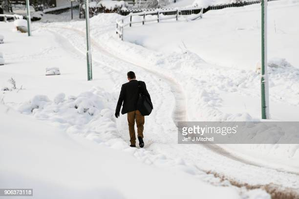 A man walks down a road following extensive snowfall during the last forty eight hours on January 18 2018 in Leadhills Scotland Motorists are being...