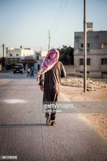 A man walks down a road in Mafraq There are about 14 million Syrian refugees in Jordan and only 20 percent are living in the refugee camps with the...