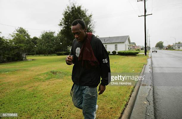 A man walks down a street as Hurricane Rita approaches September 23 2005 in Beaumont Texas Hurricane Rita which has been downgraded to Category 3 is...