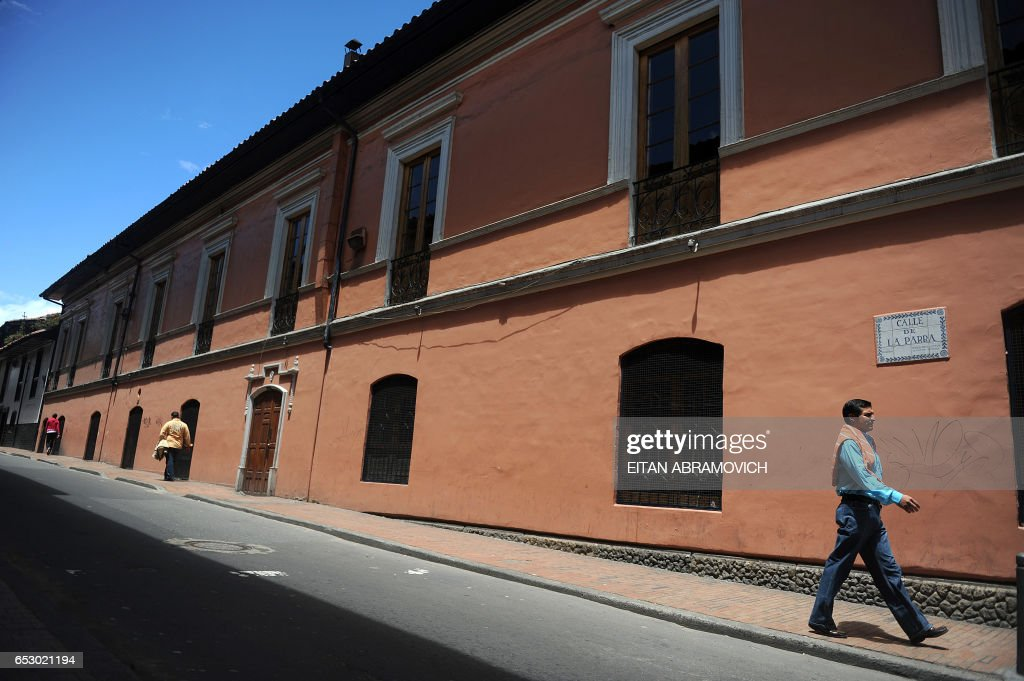 A man walks down a street in the historic neighborhood of La Candelaria in Bogota on September 17, 2009. La Candelaria is Bogota's oldest neighbourhood and the city's historical center, known for its colonial houses with wooden balconies and clay shingle roofs. AFP PHOTO/Eitan Abramovich /