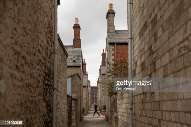 A man walks down a street in what is known as the Railway Village on February 20 2019 in Swindon England The area once housed the workers of the GWR...