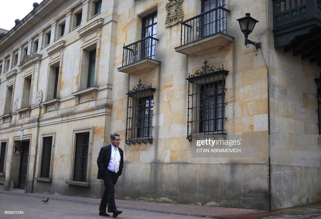 A man walks down a street of the historic neighborhood of La Candelaria in Bogota on September 17, 2009. La Candelaria is Bogota's oldest neighbourhood and the city's historical center, known for its colonial houses with wooden balconies and clay shingle roofs. AFP PHOTO/Eitan Abramovich /