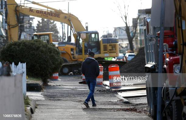 A man walks down a street shut down for construction in Lawrence MA on Dec 3 2018 By late October five weeks after gas fires and explosions rocked...