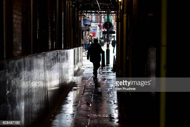 A man walks down an alleyway in Soho on March 29 2016 in London England Long established as the West Ends entertainment district with a reputation...