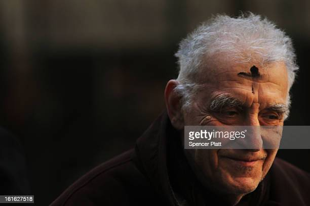 A man walks down Broadway with a cross of black ashes on his forehead on Ash Wednesday on February 13 2013 in New York City Ash Wednesday marks the...