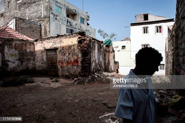 A man walks down one of the historic streets in the old city centre of Plateau on October 7 2019 in Praia