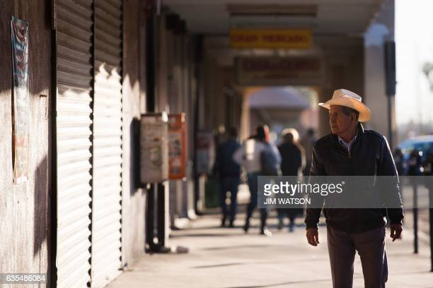Man walks down the sidewalk after leaving the Port of Entry on the US/Mexico border in Calexico, CA, on February 15, 2017. Attention Editors, this...