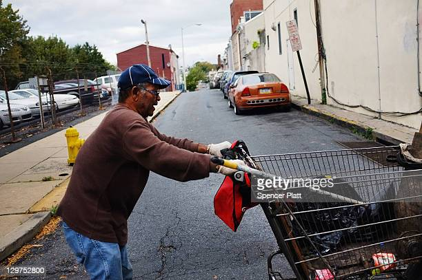Man walks down the street collecting cans on October 20, 2011 in Reading, Pennsylvania. Reading, a city that once boasted numerous industries and the...