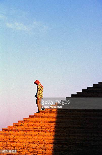 Man walks down the ziggurat at Ur, supoosedly the city of the prophet Abraham's birth. Ur was a principal city of ancient Mesopotamia. The Ziggurat...