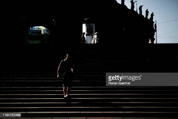 A man walks downstairs at the old town on August 21 2019 in Dresden Germany
