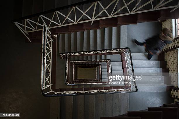 A man walks downstairs in a stairwell on January 21 2016 in Berlin