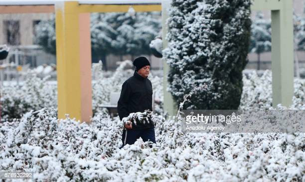 Man walks early in the morning after season's first snowfall in Usak, Turkey on November 21, 2017. Snow depth reaches 3 centimeters in town center...