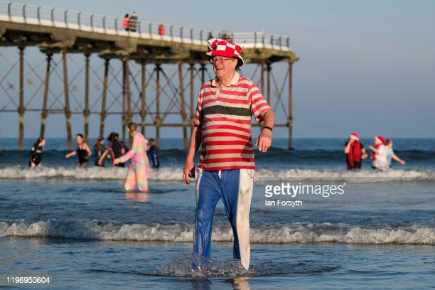 A man walks from the sea after taking part in the New Year's Day Dip on January 01 2020 in Saltburn By The Sea England The event takes place each...
