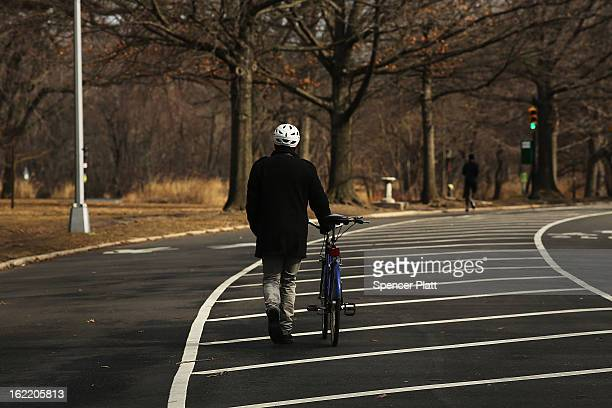 A man walks his bike in Prospect Park in Brooklyn on February 20 2013 in New York City In newly released statistics New York's largest parks...