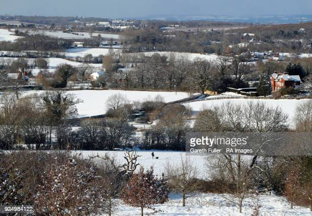 A man walks his dog in Goudhurst in Kent as heavy snowfall is affecting roads across the UK after several centimetres fell in some parts over the...