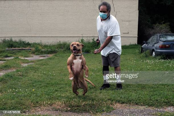 Man walks his dog in this rural Delta community on April 27, 2021 in Greenville, Mississippi. So far, an estimated 23 percent of Mississippians have...