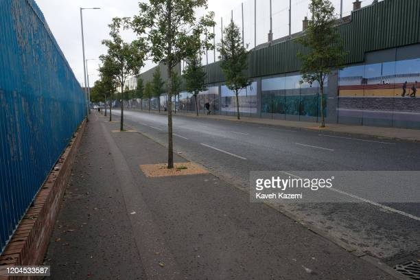 A man walks his dog on the Cupar Way which runs between the peace line dividing the Protestant and Catholic communities on October 30 2019 in Belfast...