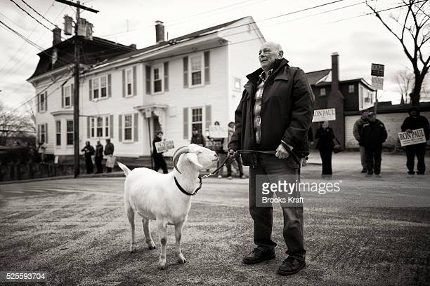 A man walks his goat outside the Republican presidential candidate in the presidential debate in Concord New Hampshire
