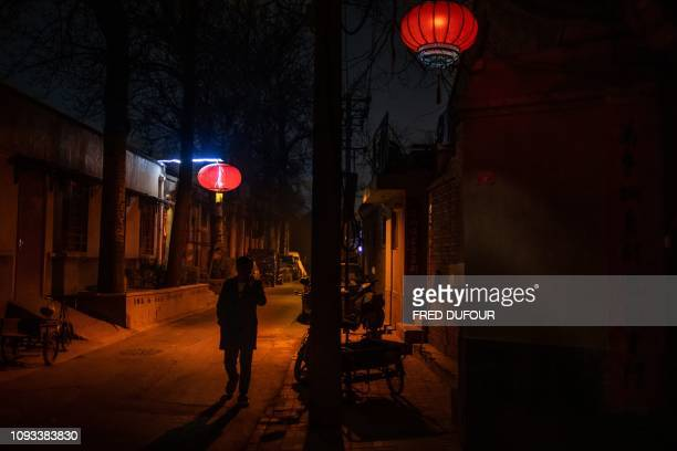 TOPSHOT A man walks in a 'Hutong' a traditional Beijing courtyard ahead of the upcoming Lunar New Year in Beijing on February 3 2019