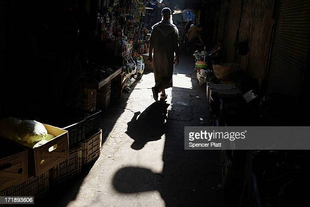 A man walks in a market on June 29 2013 in Tripoli Lebanon Tripoli Lebanon's second largest city has suffered from the spillover of Syria's...