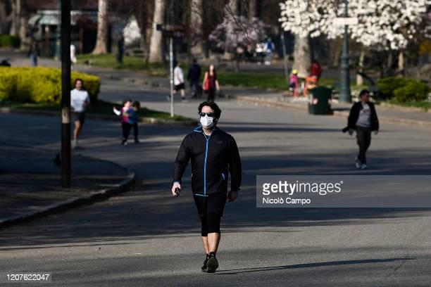 A man walks in a park The Italian government imposed unprecedented restrictions to halt the spread of COVID19 coronavirus outbreak among other...