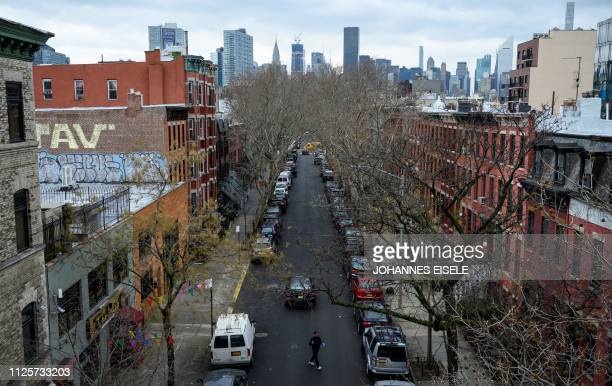 A man walks in a street in Long Island City on February 18 2019 in the Queens borough of New York City Seattlebased online retailer Amazon said they...